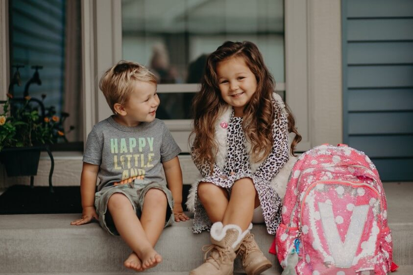 first-day-of-preschool-kids-sitting-in-front-of-house-on-steps-with-backpack_t20_yw7eBL (1)