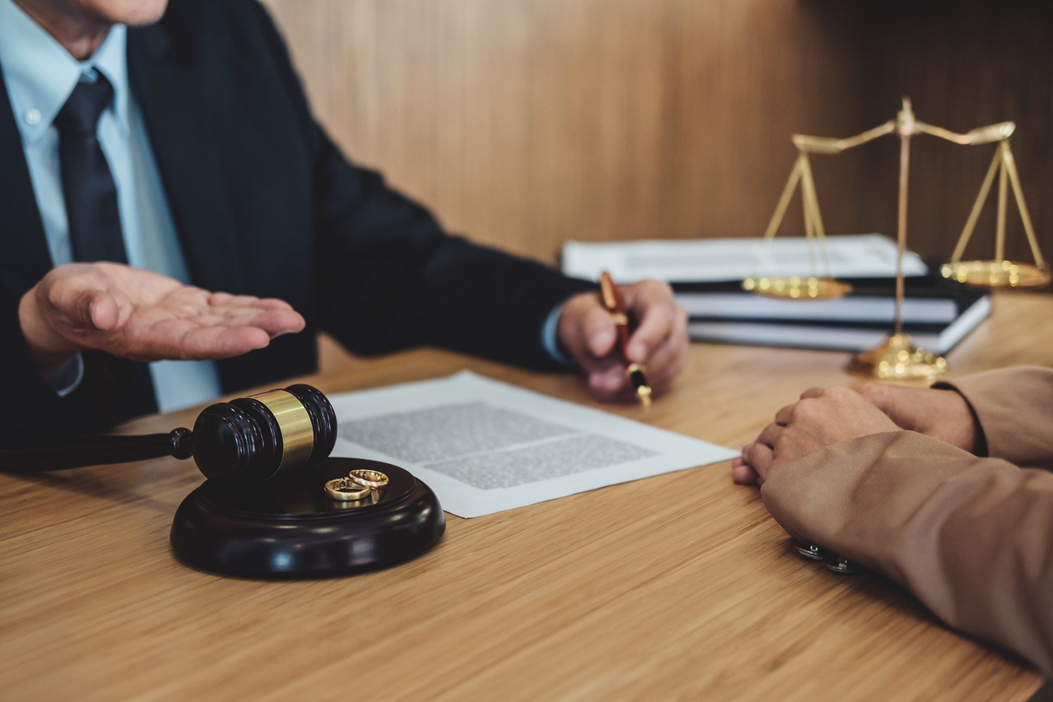 marriage-divorce-on-judge-gavel-deciding-consultation-between-a-businesswoman-and-male-lawyer-or_t20_B89apO